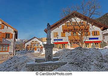 St. Antonius statue in a snowy street of Garmisch-Partenkirchen