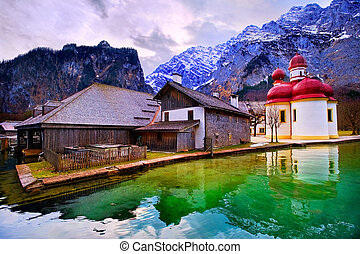 St Bartholomew church on mountain lake Konigsee in german Alps by Munich, Germany