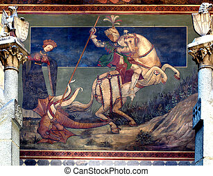 Ancient fresco of Saint George killing the drake on a medieval castle's wall