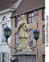 St. John of Nepomuk, John Nepomucene statue on bridge with tower of Church of Our Lady