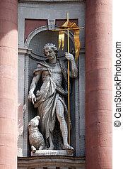 St. John the Baptist on the Facade of Neumunster Collegiate Church in Wurzburg