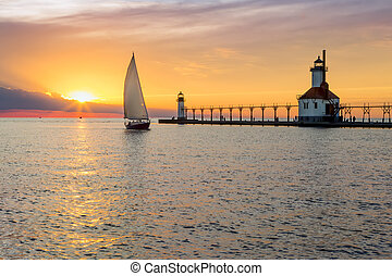 St. Joseph Lighthouse and Sailboat Solstice Sundown - A...