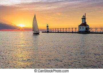 St. Joseph Lighthouse and Sailboat Solstice Sundown