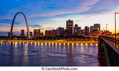 St Louis, Missouri Skyline and Gateway Arch at Night (logos...