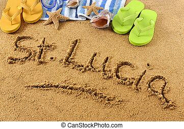 The words St Lucia written on a sandy beach, with scuba mask, beach towel, starfish and flip flops.