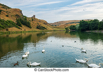 St Margaret?s Loch with ruins of St Anthony?s chapel in the background, Edinburgh, Scotland.