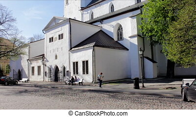Camera tilting up showing traditional medieval church. Good illustrative clip for sightseeing attraction, cultural legacy, medieval european folklore and Baltic countries, christianity and protestantism symbols, lutheran religion.