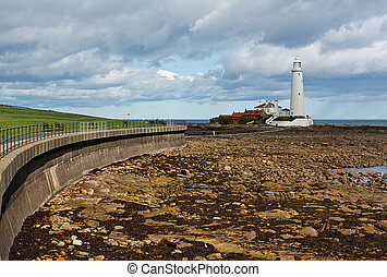 Flood defences and promenade to st marys lighthouse near tynemouth on the North East Coast of England.