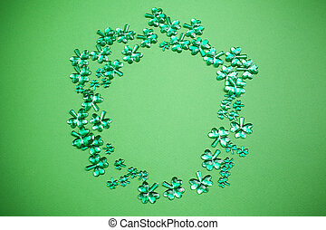 St Patrick's Day background. Lucky spring with shamrock. Green clover wave border on green background.