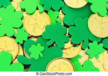 St Patricks Day background of shamrocks and gold coins