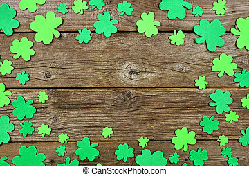 St Patricks Day frame of shamrock, top view over an old wood background with copy space