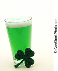 St Patricks Day green beer and shamrock - Green beer in a...