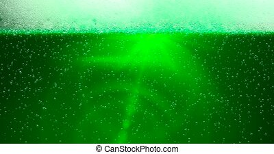 St. Patrick's Day Green Beer background with lens flare. For festive pub party event. 3d render, loop 4k