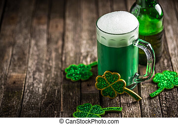 St. Patricks Day green shamrocks with a full cold frosty ...