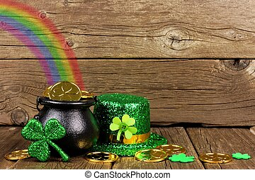 St Patricks Day Pot of Gold with rainbow & decor against wood