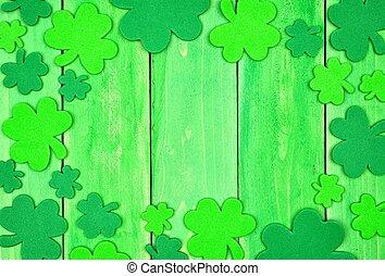 St Patricks Day shamrock frame over green wood