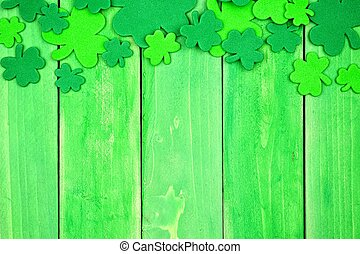 St Patricks Day shamrock top border over green wood