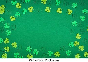 St Patricks Day shamrocks frame over a green background