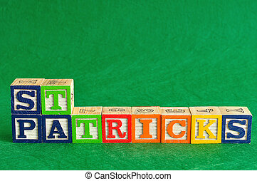 St Patrick's day spelled with colorful alphabet blocks on a green background
