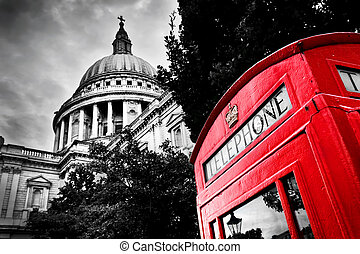 St Paul's Cathedral dome and red telephone booth. London, the UK.