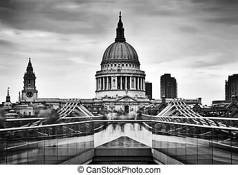 St Paul's Cathedral dome seen from Millenium Bridge in London, the UK.