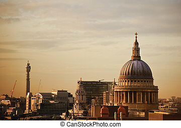 Lovely colorful image of St Paul's cathedral in London during Winter sunset over city skyline