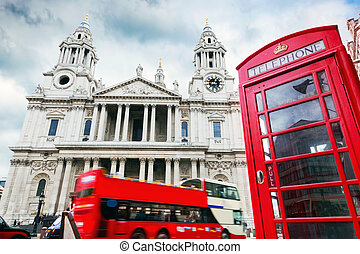 St Paul's Cathedral, red bus, telephone booth. Symbols of London, UK.