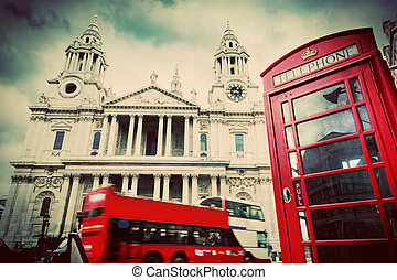 St Paul's Cathedral, red bus, telephone booth. Symbols of London, UK. Vintage
