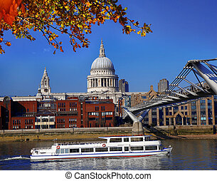 St Paul's Cathedral with tourist boat in London, England