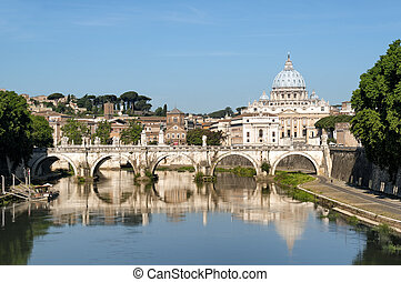 St. Peter's Basilica, Ponte Sant Angelo and Tiber River in Rome - Italy.