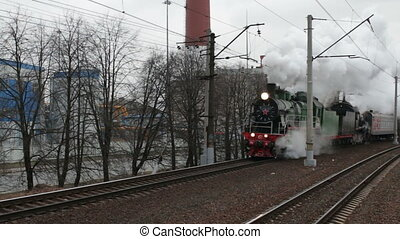 steam train in a cloud of smoke is approaching - St....