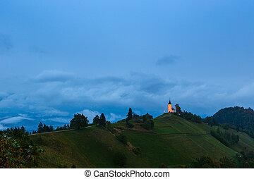 St. Primoz church on the hill at sunset at Jamnik