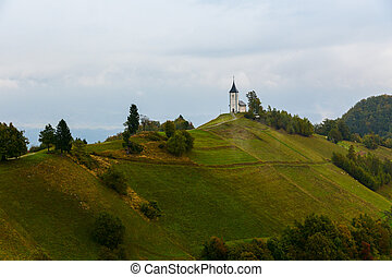 St. Primoz church on the hill at sunset at Jamnik, Slovenia
