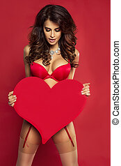 St. Valentine's Day. - Sexy brunette woman in red lingerie...