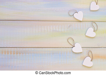 St. Valentine's wooden background with wooden hearts