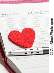 Pen, heart and notebook