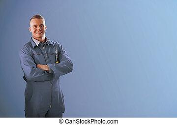staand, blauwe , werktuigkundige, achtergrond, voorkant
