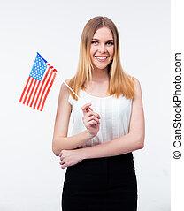 staand, businesswoman, jonge, ons vlag, vrolijke