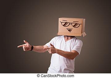 staand, doosje, hoofd, zijn, smiley, jonge, gezicht, karton, gesturing, man