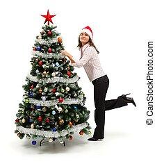 staande vrouw, dichtbij, verfraaide, kerstboom
