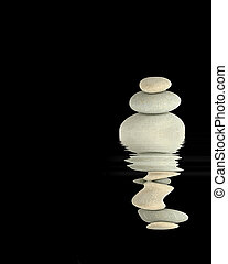 Stability - Zen abstract of three gray spa balanced on top...