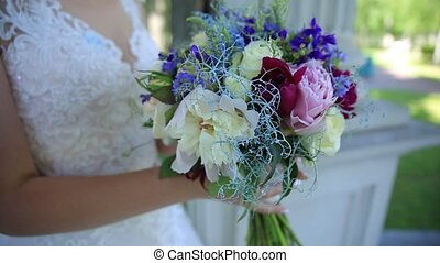 stabilizer, bouquet of wildflowers in the bride's hand