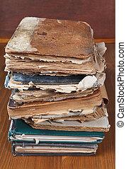 antique books on wooden bookshelf