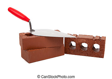 A stack of bricks with a mortar trowel on a white background