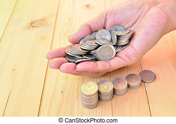 stack coins put on hand for save money and financial, tax season