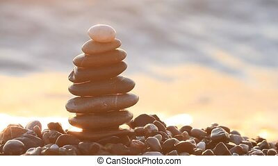 Stack of a stones on sunrise