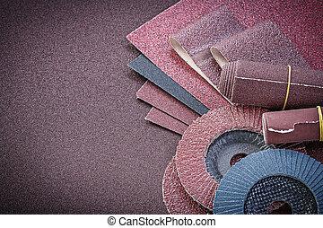 Stack of abrasive equipment on polishing sheet.