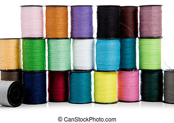 Stack of assorted threads on a white background