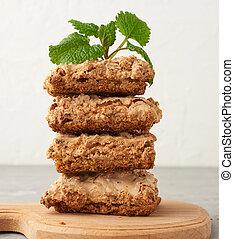 stack of baked Krakow meringue cookies on a wooden board