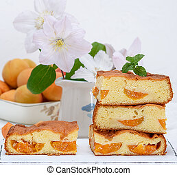 stack of baked square slices of a biscuit pie with apricots